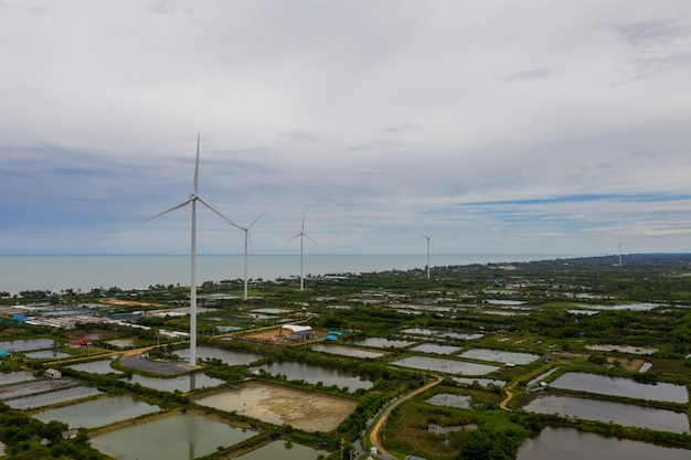 Aerial shot of wind mills rotating by the force of the wind and generating renewable energy