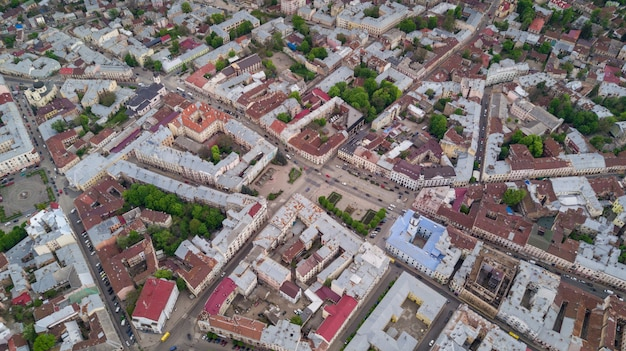 Aerial summer view of central part of beautiful ancient ukrainian city chernivtsi with its streets, old residential buildings, town hall, churches etc. beautiful town