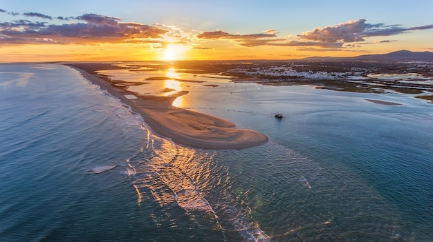 Aerial. sunset landscape from the sky of fuseta bay beach.