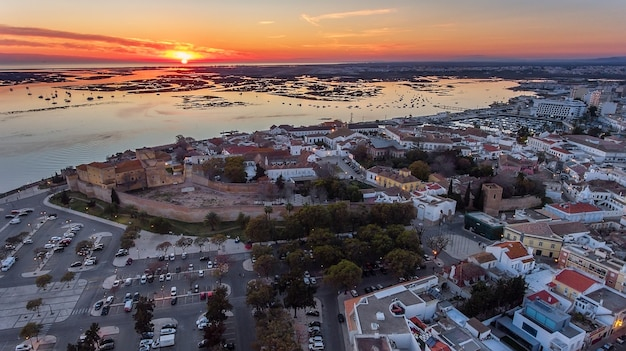 Aerial. sunset over the old town of faro, view from the air, portugal
