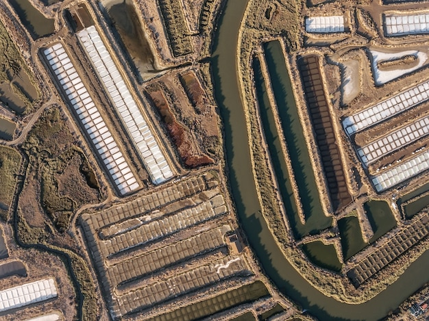 Aerial. textured fields of swampy salt lakes. salines portugal. vila real santo antonio.
