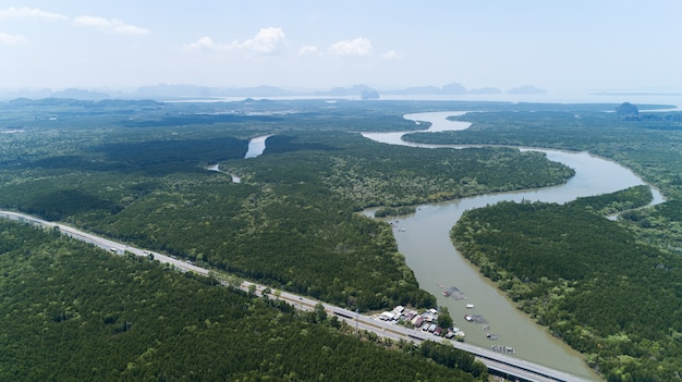 Aerial top down drone shot of bridge with cars on bridge highway road and landscape mountain view nature image transportation background and business travel concept.