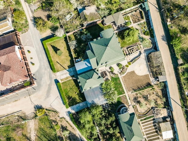 Aerial top down overhead view of summer luxury house