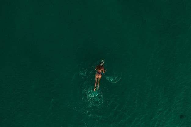 Aerial top nature view green turquoise thracian sea greece ellada. beautiful young woman bikini