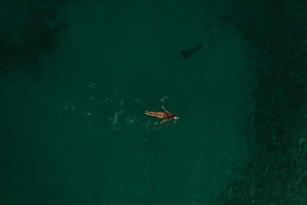 Aerial top nature view thracian sea greece ellada. beautiful young woman bikini swimming