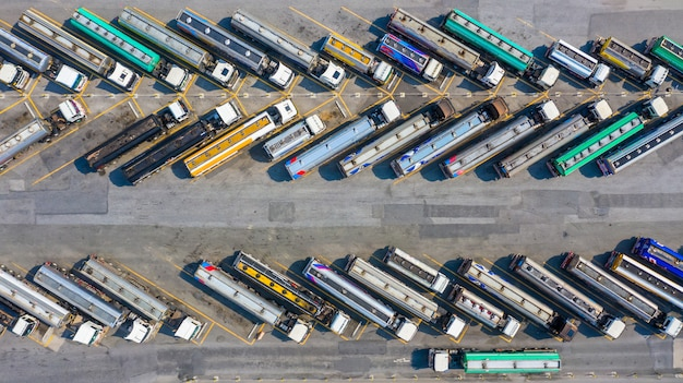 Aerial top view automotive fuel tankers shipping fuel.