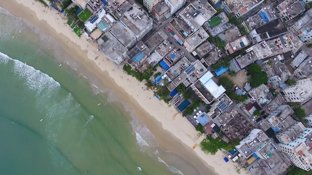 Aerial top view of beach in china small town in hainan in china