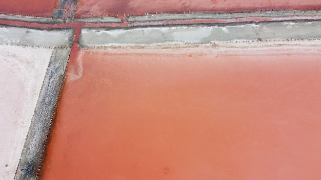 Aerial top view of beautiful salt lake with pink water. view of pink lake from flying drone. drone copter photography from above. landscape with drone