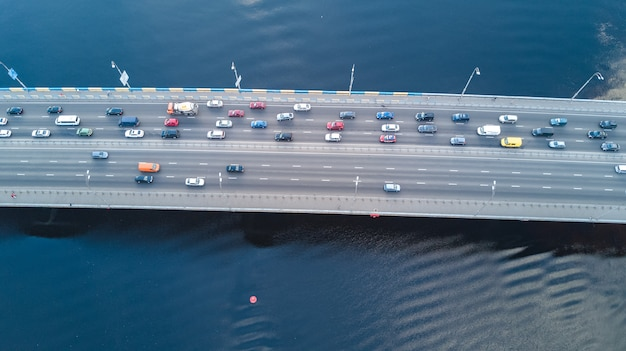 Aerial top view of bridge road automobile traffic of many cars from above, city transportation concept