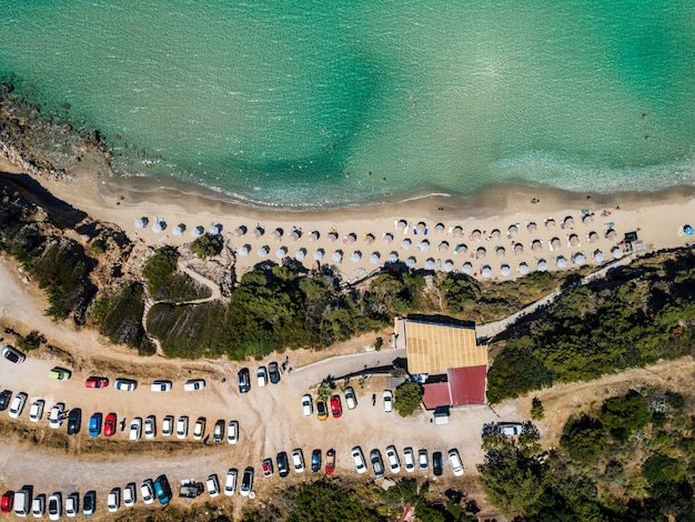 Aerial top view by drone of tropical beach of voulisma beach on crete