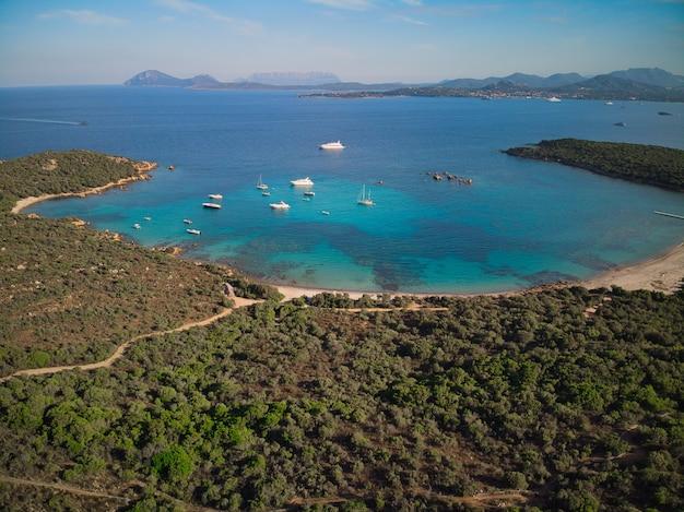 Aerial top view of cala petra ruja beach in porto cervo Premium Photo