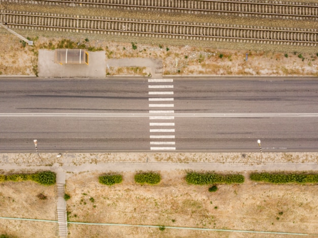 Aerial top view of crosswalk on a countryside fast speed road  f