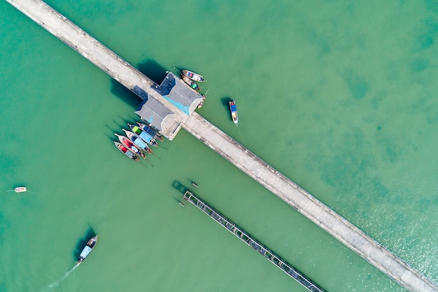 Aerial top view drone shot of bridge with long tail boats fisherman in summer season