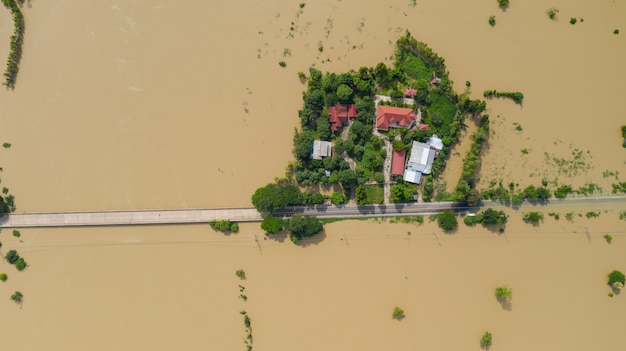 Aerial top view of flooded rice paddies and the village, view from above shot by drone