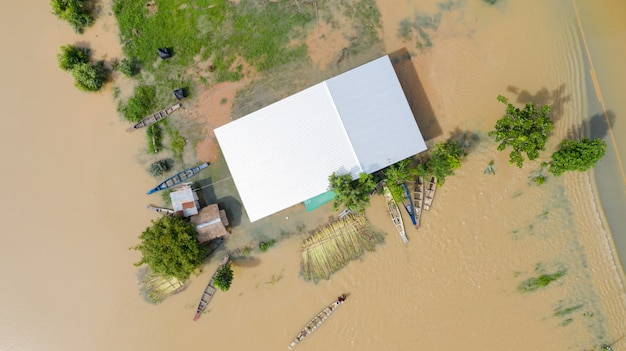 Aerial top view of flooded rice paddies and the village