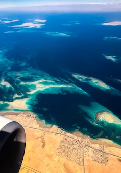 Aerial top view from airplane coastline egyptian desert islands