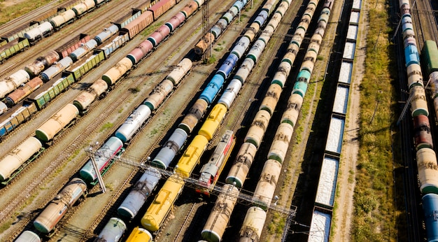 Aerial top view of industrial cargo trains on a railway tracks  f
