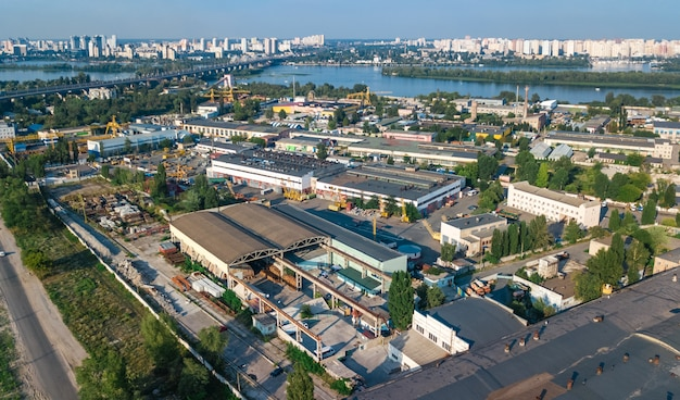 Aerial top view of industrial park zone from above, factory chimneys and warehouses, industry district in kiev (kyiv), ukraine