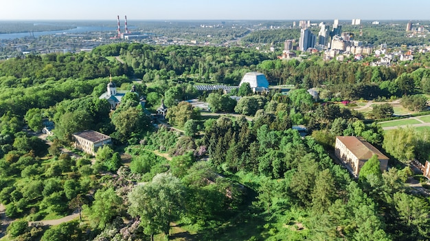 Aerial top view of kiev city from above, kyiv skyline and dnieper river cityscape in spring, ukraine