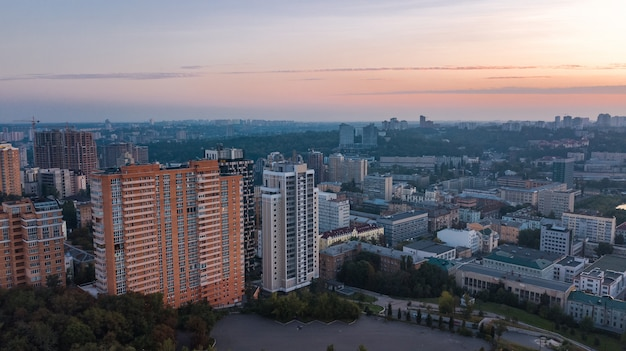 Aerial top view of kiev city skyline on sunset from above, kyiv center downtown cityscape in evening, capital of ukraine