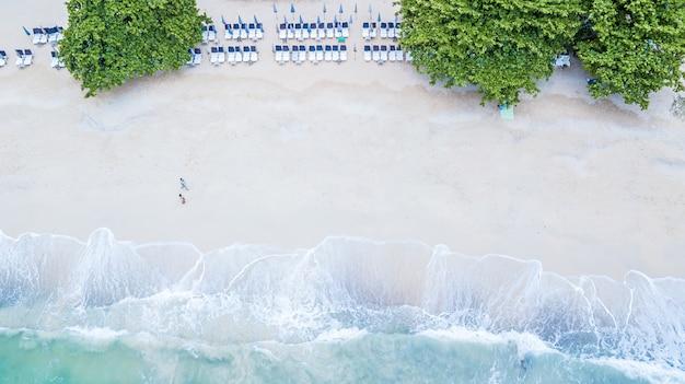 Aerial top view of koh lan beach with tropical blue clear sea water, koh lan, pattaya, thailand.