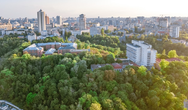 Aerial top view of kyiv cityscape of vozdvizhenka and podol historical districts on sunset from above, city of kiev, ukraine