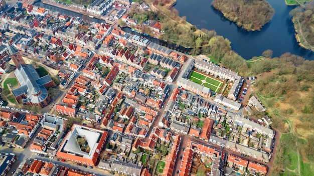 Aerial top view of naarden city fortified walls in star shape and historic village in holland from above, netherlands