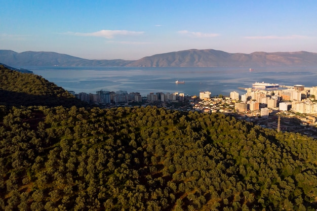 Aerial top view of olive fields in the mountain and sea coast in albania city.