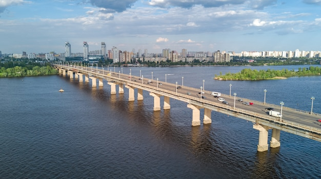Aerial top view of paton bridge and dnieper river from above, city of kiev, kyiv cityscape skyline, ukraine