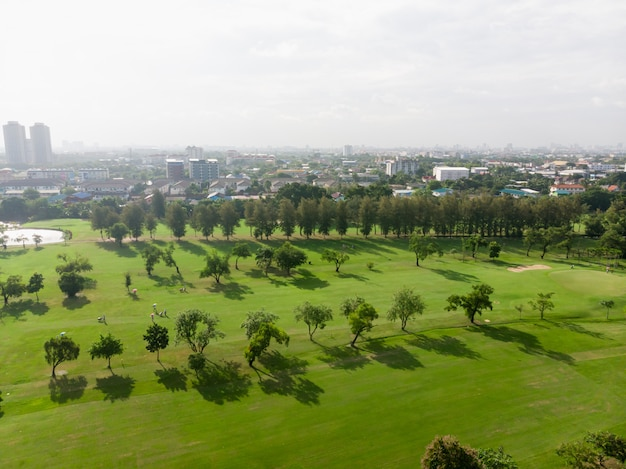 Aerial top view photo from flying drone of golf course, lush green grass on golf course