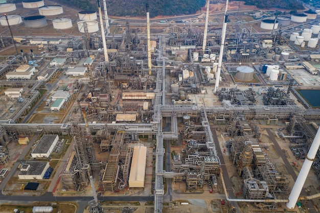Aerial top view refinery oil petroleum chemical industry business pipeline and storage thanks factory zone