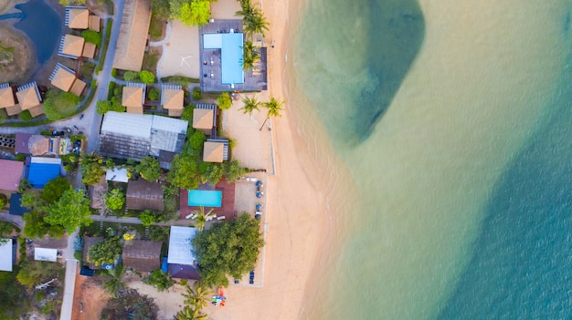 Aerial top view, resort and beach with emerald blue water on beautiful tropical sea in thailand