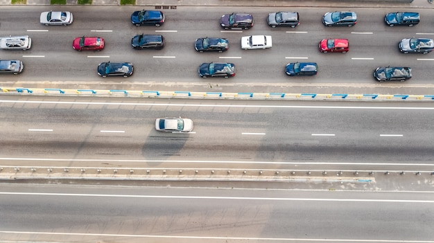 Aerial top view of road automobile traffic of many cars on highway from above, city transportation concept