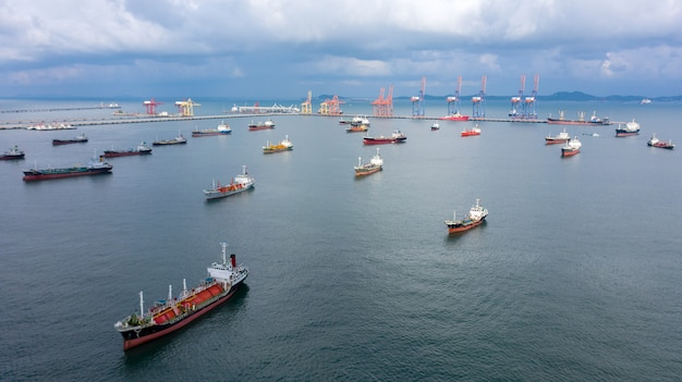 Aerial top view of the ship carrying the lpg and oil tanker in the sea port