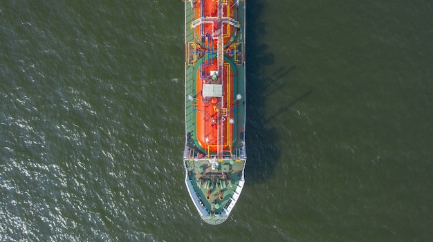 Aerial top view of the ship carrying the lpg tanker in the sea port