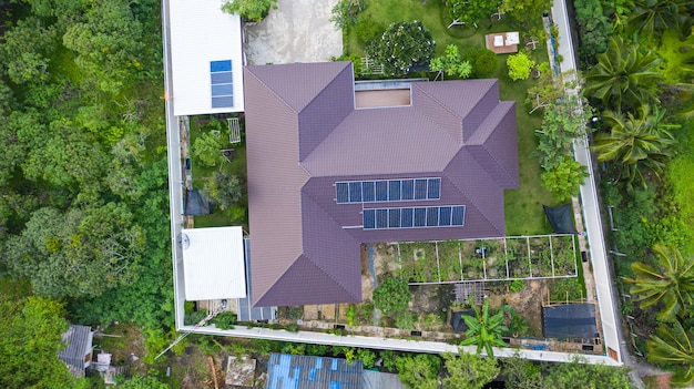 Aerial top view of the solar cells on the roof, solar panels installed on house roof taken with the drones