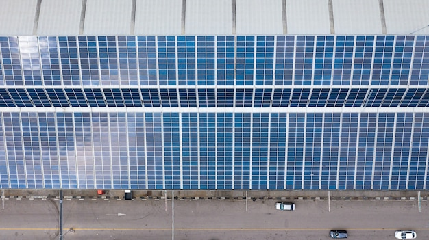 Aerial top view of the solar cells on the roof
