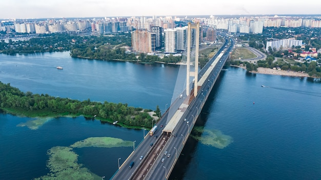Aerial top view of south bridge in kiev city from above, kyiv skyline and dnieper river cityscape, ukraine