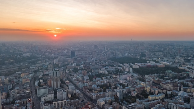 Aerial top view of stadium and kiev cityscape on sunset from above, city of kyiv skyline, ukraine