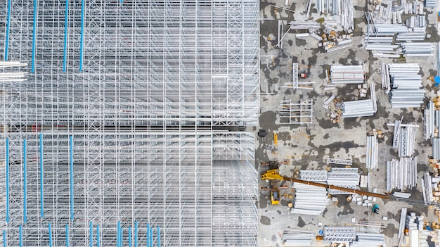 Aerial top view structure of steel building construction, metal steel frame buildings construction design, aerial view construction site.