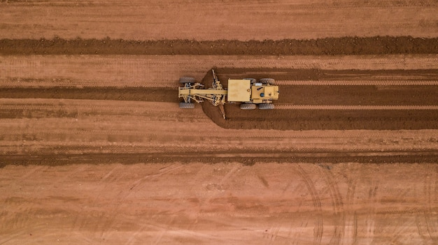 Aerial top view tractor at work