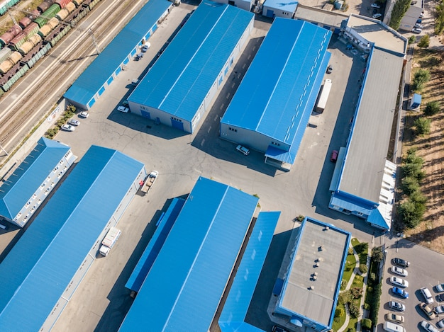 Aerial top view of warehouses hangars near the industrial factory zone f