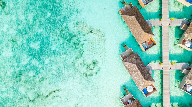 Aerial top view water villa at maldives island