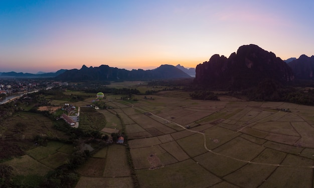 Aerial: vang vieng backpacker travel destination in laos, asia
