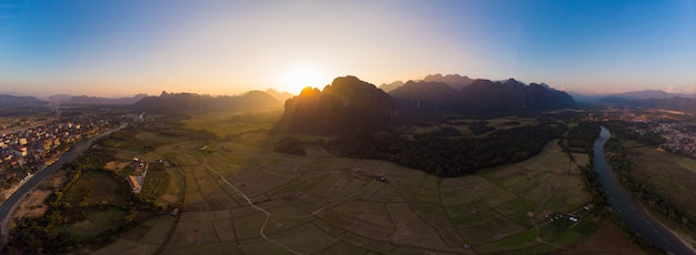 Aerial: vang vieng backpacker travel destination in laos