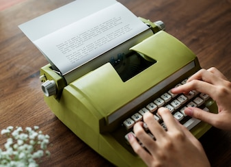 Aerial view a woman using a retro typewriter