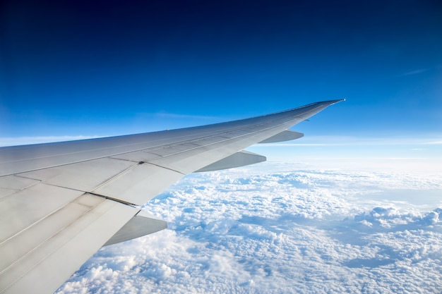 Aerial view of amazing blue sky and cloud from window view of airplane during air transpor