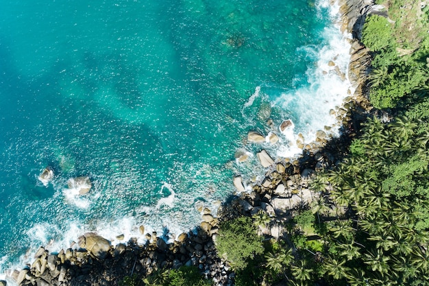 Aerial view of amazing seashore at phuket thailand beautiful seacoast and open sea in summer season nature recovered environment and travel background.