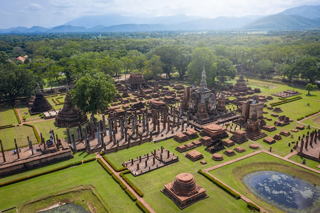 Aerial view of ancient buddha statue at wat mahathat temple in sukhothai historical park, thailand.