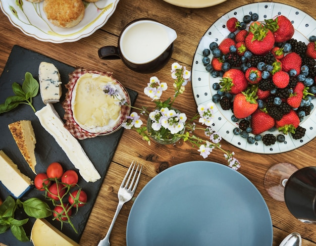 Aerial view of appetizer with cheeses and berries